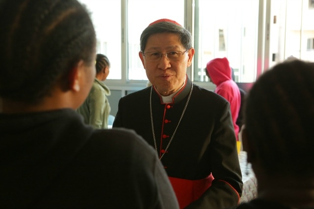 Cardinal Luis Tagle, president of Caritas Internationalis, met with trafficking survivors from Africa earlier in the year on a visit to the Middle East. Credit: Caritas