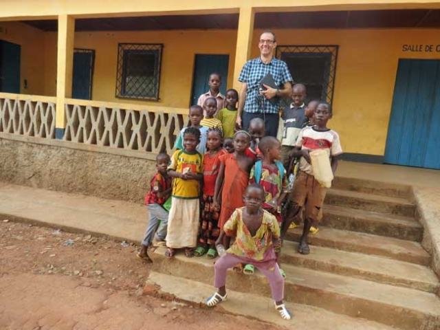 Fr. Luk and some children at one of Caritas camps for the IDPs. Children need to get back to school. Photo by Caritas Central African Republic