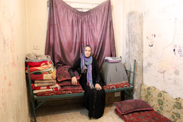 "Majida, 45, mother of four children,""Every day, I pray to God to put an end to this war, to be able to go back home."" Photo by Caritas Syria"