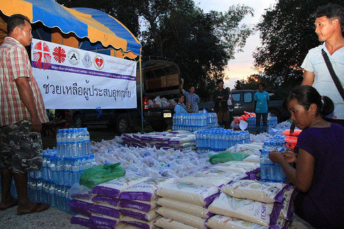 Monks, punks and priests help Thailand after floods