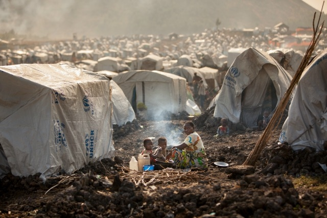 Family eating dinner at refugee camp Mugunga 3 in Goma, North Kivu, Congo