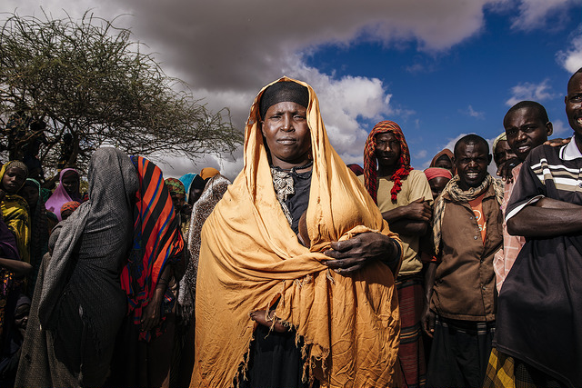 The epicentre of the food crisis is around south-central Somalia and the capital Mogadishu, where thousands of people are seeking survival in makeshift camps with unsanitary conditions. Cholerea has broken out. Shanties Dhuyuleh Internally Displaced Persons Camp. Caritas member Trocaire gives food ration cards. Photo by Amunga Eshuchi/Trocaire