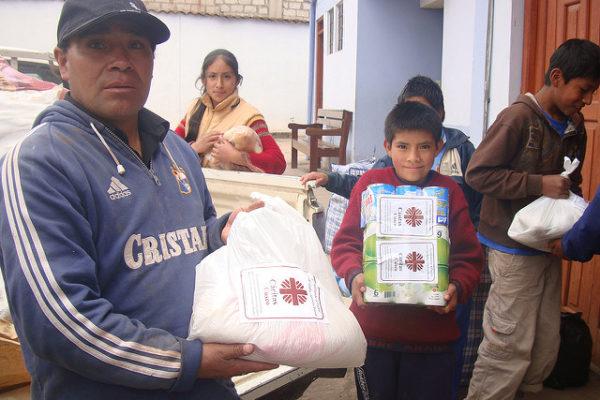 Caritas distributing aid in flood affected areas in Peru