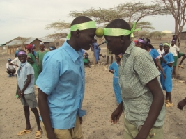 At a Peace Camp in northern Kenya, children from rival tribes play teambuilding games. Credits: Diocese of Marsabit