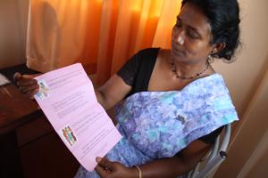 Monica Dulanthi, age 48, is a Sri Lankan woman who worked in several Middle Eastern countries as a maid. In Saudi Arabia, her employers did not give her enough food and locked her in. With CRS funding, Caritas Sri Lanka published a booklet of important phrases in several languages in case workers get in trouble. Caritas also distributes safe migration info in churches, Buddhist temples, and elsewhere. Credits: Sheahen/Caritas