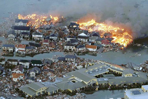 Houses swept out to sea burn following a tsunami and earthquake in Natori City in northeastern Japan March 11, 2011. The biggest earthquake to hit Japan since records began 140 years ago struck the northeast coast on Friday, triggering a 10-metre tsunami that swept away everything in its path, including houses, ships, cars and farm buildings on fire. Credits: YOMIURI/REUTERS/Alertnet.org