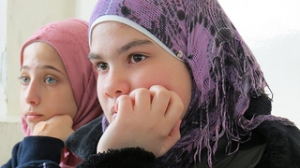 Caritas volunteers provide informal education to Syrian refugee children in Zarqa. Credits: Nicholson/Caritas
