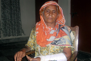 Khursheed Bibi, a Caritas beneficiary, with a bandage worn around her fractured arm Credits: Caritas