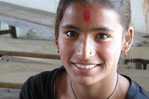 Like many teenage girls in impoverished Nepal, Sushila is vulnerable to employment scams. Caritas pays school fees for Sushila and others, making sure teenage girls stay in school. Credits: Sheahen/Caritas