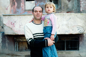 The Center for Collective Bair, in the Albanian part of Mitrovica, gives shelter to Kosovar Albanian families from northern Kosovo, who were forced to move south after the 1999 war. Shukri Rushiti Hanifi and his daughter at the entrance of the center. Credits: Xavier Schwebel/Secours Catholique-Caritas France