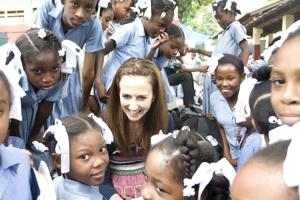 Irish television presenter Lorraine Keane with young girls at the Ecole Anne Marie Javouhey in Port au Prince where Trocaire funded school repairs and a feeding programme after the earthquake. Credits: Jeannie O'Brien/Trocaire