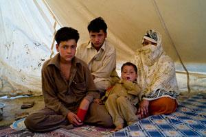 A Swat family in a small tent camp in Mardan district. Credits: Hamish Cairns/Caritas