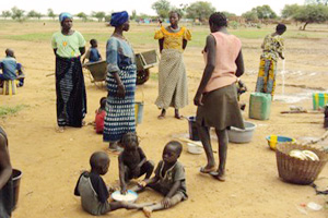 Women and children in Burkina Faso, where nearly two million people face hunger. Credits: Caritas