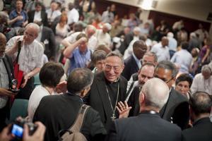 Caritas representatives congratule Cardinal Rodríguez Maradiaga for his re-election as Caritas Internationalis president. Credits: Caritas/Elodie Perriot