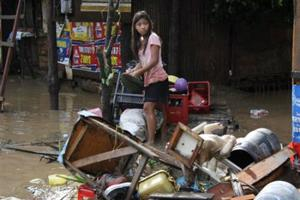 A girl searches for salvageable items after flash floods brought by Typhoon Washi (Sendong) in Macasandig town, Cagayan De Oro city, southern Philippines December 17, 2011. Credits: REUTERS/Stringer courtesy of alertnet.org