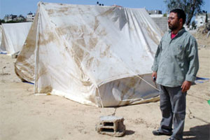 Ashraf Abed Rabo who is a father of nine lost his house in a missile attack by an Israeli plane. The house was demolished so he was forced to seek shelter in two tents. Credits: Caritas Jerusalem