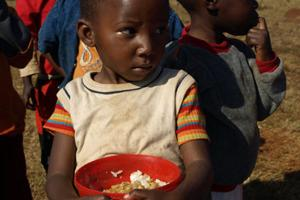 Children need to eat nutritious food not only while taking ARVs, but also before starting treatment. Credits: Hough/Caritas