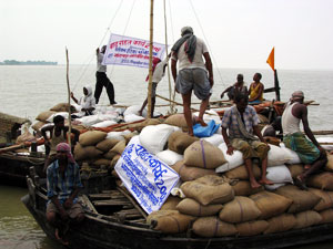 Two boats with relief supplies. Rescue efforts have been difficult due to lack of boats and trained rescue teams. Credits: Caritas India