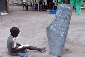 A child is learning English through a homeschool in Rumbek, South of Sudan Credits: Limburger/Caritas Austria