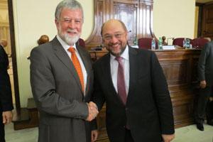 Representing Caritas Internationalis, Justin Kilcullen, and Martin Schulz, President of the European Parliament (Right).