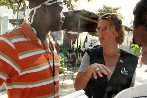 CRS/Caritas USA AidsRelief Haiti chief of party, Anna van Rooyen, talks with doctors at St. Francois de Sales hospital in Port au Prince, Haiti Credits: Lane Hartill/Catholic Relief Services