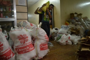 The Caritas Manila office has been transformed into loading centre as 250 volunteers work in shifts to pack aid destined for people in the most affected regions of the country. By Eoghan Rice/Caritas