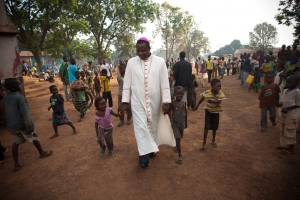 Archbishop of Bangui, Dieudonne Nzapalainga (C), visits Displaced Persons (IDP's) on November 12, 2013 in Bossangoa, 380 km north of Bangui. 41.000. Credit: Matthieu Alexandre/Caritas