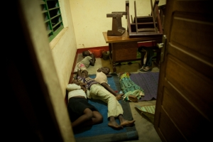 Internally Displaced Persons (IDP's) lie on the floor of Caritas desk room next to the Cathedral on November 9, 2013 in Bossangoa, 380 km north of Bangui. Creadit: Matthieu Alexandre/Caritas