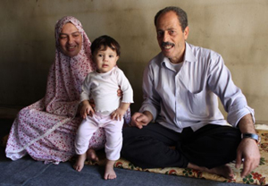 Adnan with wife and granddaughter. Credit: Val Morgan/Sciaf