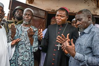 Archbishop Dieudonné Nzapalainga of Bangui joins Muslims in prayer for an end to the crisis in the Central African Republic. Credit: Sam Phelps for Catholic Relief Services.