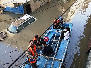 Despite the floods Caritas Jerusalem's medical team took boats, grabbed ladders and assisted many stranded families with medicines, first aid and food. Credit: Caritas Jerusalem