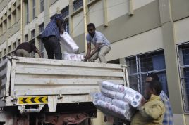 ECS staff loading the materials purchased for the returnees from Saudi Arabia. Credit: ECS