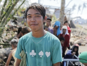 cleanwaterPHIEdzil, a survivor of the typhoon, waits to collect drinking water