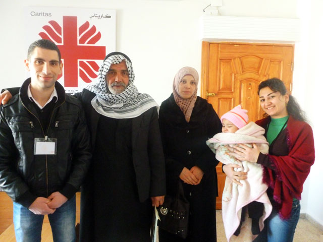 Caritas-Syria-staff-with-beneficiaries