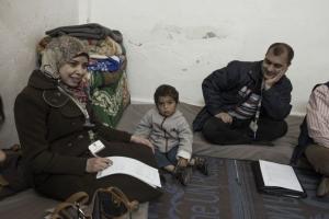 Yahia with a Caritas Jordan social worker. Credit: Alessio Romenzi/Caritas Switzerland