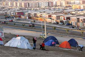 People camping in tents. Almost 1 million people have been evacuated. Credit: Caritas Chile
