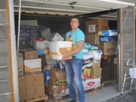 Caritas Bosnia Herzegovina volunteers helping distribute food and other aid to those in need. Credit: Caritas BiH
