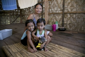 Leslie Montanejos, her husband and children are one of the families to benefit from a new home after Typhoon Haiyan. Photo by Jennifer Hardy/Catholic Relief Services