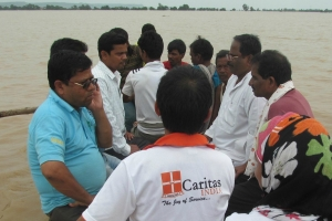 Caritas India emergency team travel by boat in areas flooded in Odisha. Credit: Caritas India