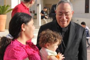 Cardinal Rodriguez meeting Syrian and Iraqi refugees in Jordan in May. Credit: Dana Shahin/Caritas Jordan