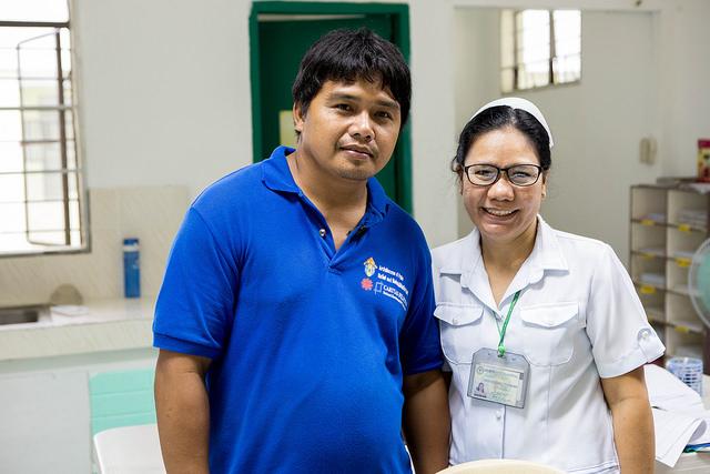 Ronald and nurse Hilda Ponferrada, who saved many people's lives. Photo by Lukasz Cholewiak/Caritas.