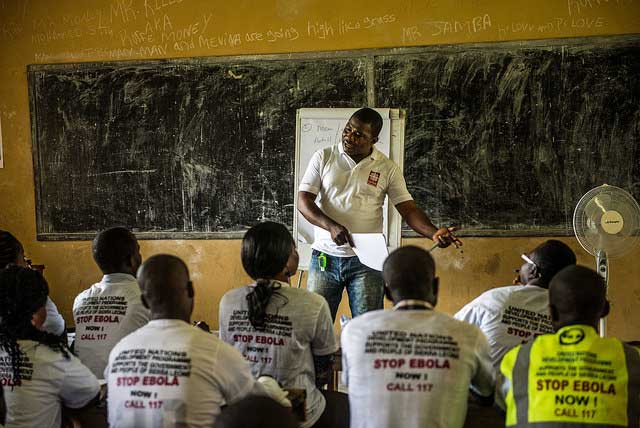 Idriss Gibson Mansaray conducts a training with Caritas community health volunteers in Hastings.