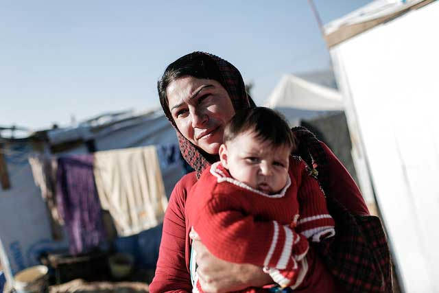 "Shereen Sabah, 34,""But it's more difficult now i have the baby. It's very cold in the tent, and draught too. The baby is always sick and vomiting. There are doctors here but still she's always sick of the cold."" Photo by Sam Tarling/Caritas"