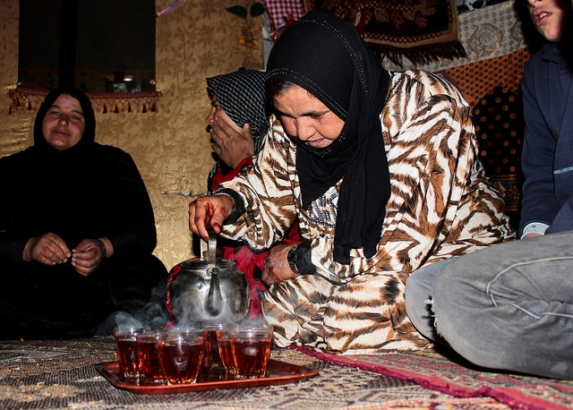 Syrian women refugees making tea to keep warm from sub-zero winds. Credit: CLMC/Jean J. Khoury