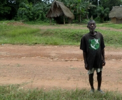 Charles Rennie has single handedly buried 38 friends, family and neighbours in the village of Bella Kartala in Bong County without protective gear. He now faces stigma. Credit: Caritas