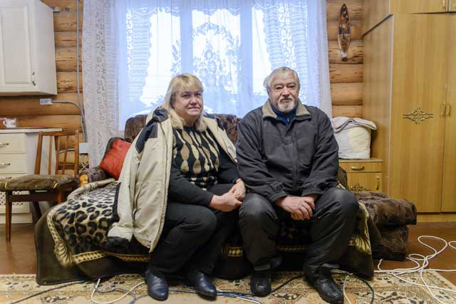"""In rural Izyum in eastern Ukraine, being displaced has separated families and the loneliness weighs heavily. """"Our lives are radically different now. We used to have jobs, we were occupied. Now we have nothing. We are sitting here waiting for the end of life."""" said Lariss (L) and Yuriy Chernov (R). Ukraine conflict 2015"""