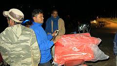 Distribution of tarps by Caritas Nepal staff Prakash Khadka. Credit Caritas Nepal