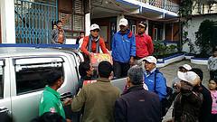 Caritas staff distributing dry food goods after the earthquake. Credit: Caritas Australia