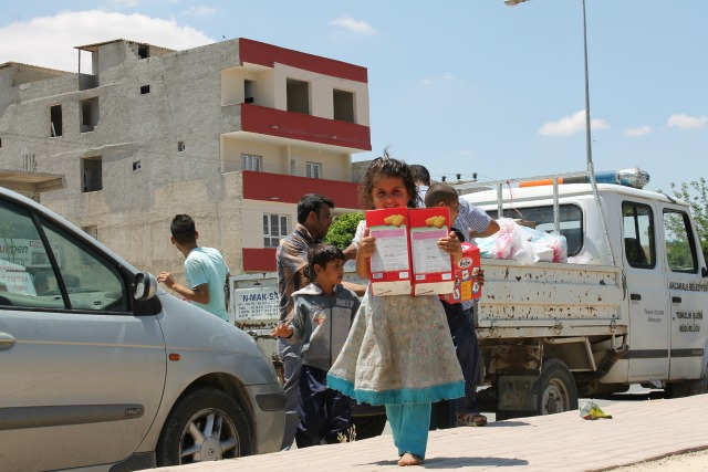 aid includes diapers, sanitary pads,  towels,  milk and baby food. Credit: Caritas Turkey
