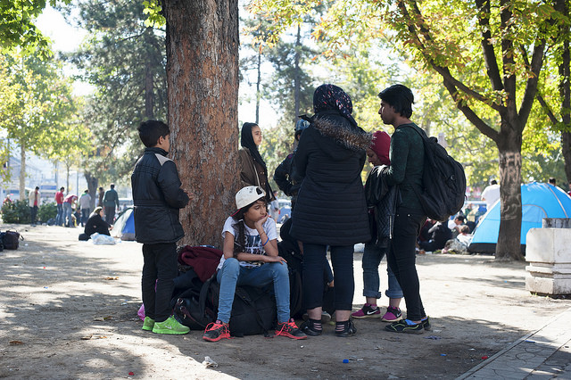 Refugees in Serbia wait in a park adjacent to the Belgrade main bus station hoping to board buses for the Hungary boarder. Photos by Kira Horvath for Catholic Relief Services